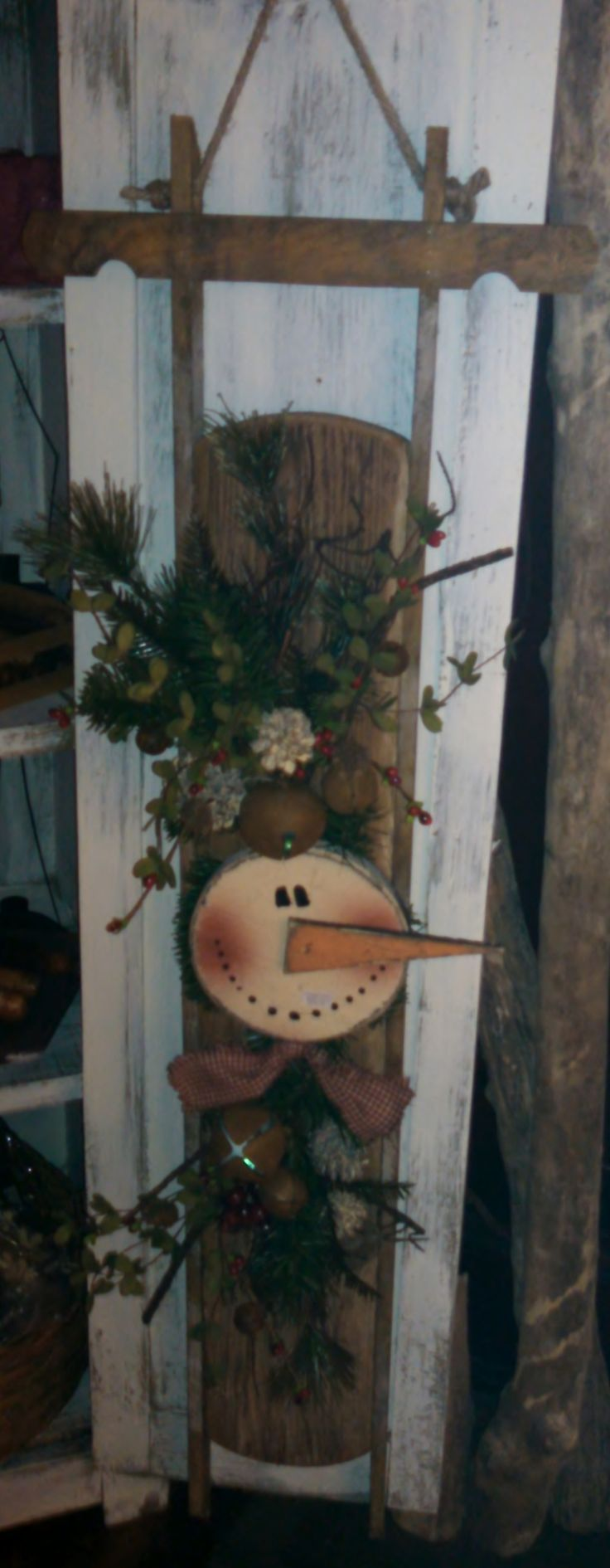Tobacco lathe sled with prim snowman and greenery.