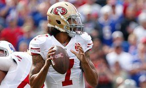 Colin Kaepernick drops back to pass during the first quarter against the Buffalo Bills