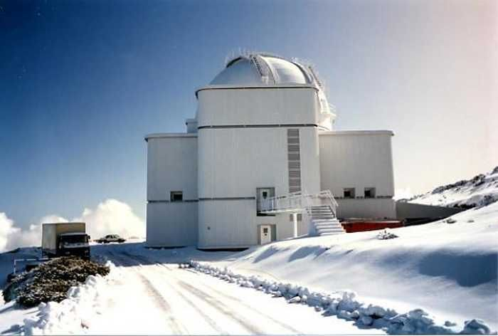 The Isaac Newton Telescope in the snow, Roque de Los Muchachos observatory, Garafía, La Palma
