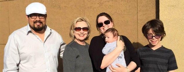 Hillary Clinton meeting a family at a gas station in Pennsylvania. (via Twitter/HillaryClinton) Clinton heads to Iowa -  in a minivan A few hours into the surprise 1,000-mile drive, she tweets a picture of herself meeting a family at a gas station. What she'll focus on