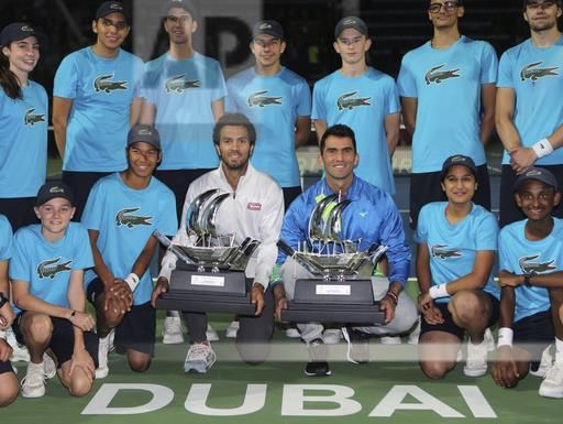 Netherlands' Jean-Julien Rojer, centre left, and Romania's Horia Tecau, hold the trophy after they beat India's Rohan Bopanna and Poland's Marcin Matkowski during a doubles final match of the Dubai Tennis Championships, in Dubai, United Arab Emirates, Saturday, March 4, 2017. (AP Photo/Kamran Jebreili)