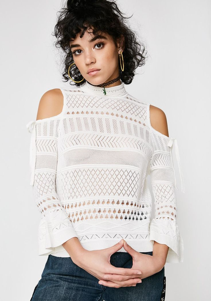 Lira Clothing Annabel Top has got ya feelin' fine af. Give 'em the cold shoulder in this pretty pointelle knitted mock turtleneck top that is sheer with a hook N' eye back closure.