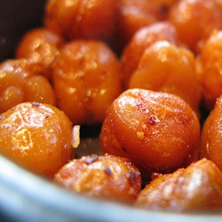 "Spicy Roasted Chickpeas, NEW FAVORITE SNACK!! Soooooo good. (They taste like spicy, crunchy croutons! Whenever I've made them, people say, ""What are these!"")"