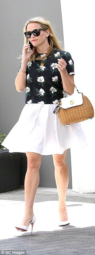 Familiar fabric: Earlier on the same day, Reese wore a blouse made of the same flowered fabric used for her tote bag - both items came from the actress' Draper James clothing line