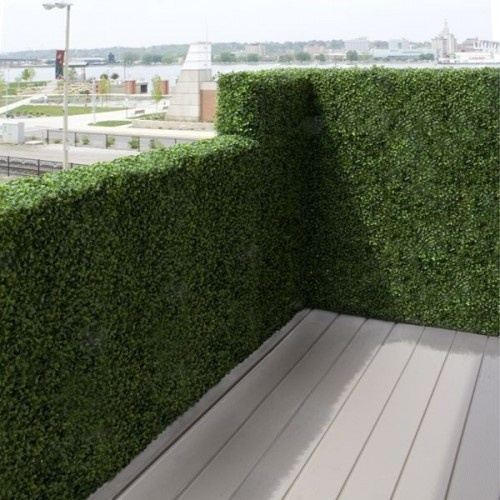 Balcony Privacy screen -This realistic artificial outdoor boxwood hedge fits over the top of balcony railings to provide privacy and year-round foliage. By Home Infatuation.