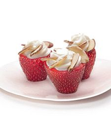 Martha Stewart's Cheesecake Filled Strawberries.  I love the Royal no bake cheesecake, so I wonder if it would set up in strawberries.  Hmmm....  I also wonder if I could make it work with lemon icebox pie...use that in the strawberries.  YUMMMMM