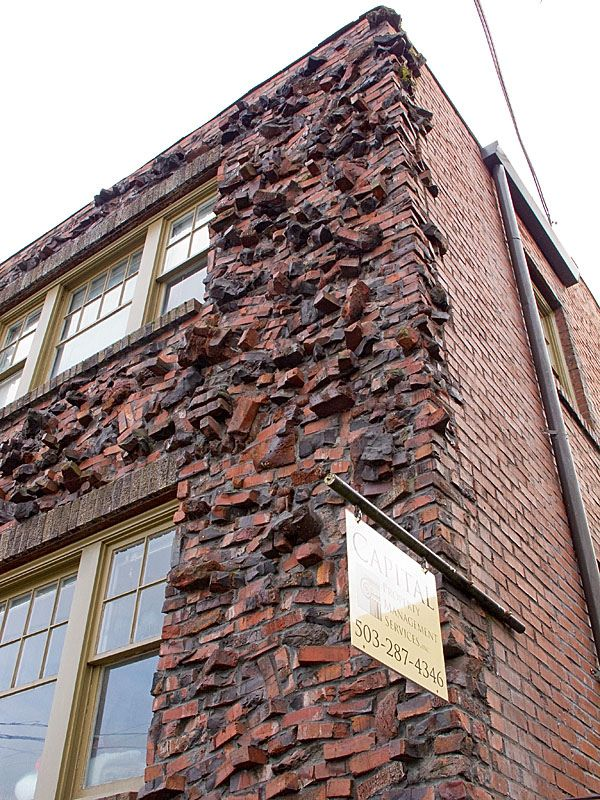 """https://flic.kr/p/8UWNKx   2010-01-03 clinker bricks on hawthorne   There is a wonderful building on SE Hawthorne in Portland, OR and the front facade is built using clinker bricks which gives a fascinating texture and look to the structure.   Here's a definition of the term:  """"Originally discarded because they were discolored or distorted, around 1920 clinker bricks were re-discovered by Craftsmen architects to be usable, distinctive, and charming in detailing. The name """"clinker brick""""…"""