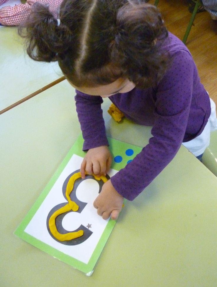 Traç de números amb xurrus de plastilina