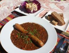 Lentil Soup with Frankfurter 1 ham hock or approx. 1 cup of dice ham 2 quarts Chicken, beef or ham stock (8 cups) 2 cups chopped onion (1 medium onion ) 2 cups chopped celery heart, with green tops (stalks) 2 cups chopped carrots (3 large) 1 pound bag dry lentils sorted and cleaned