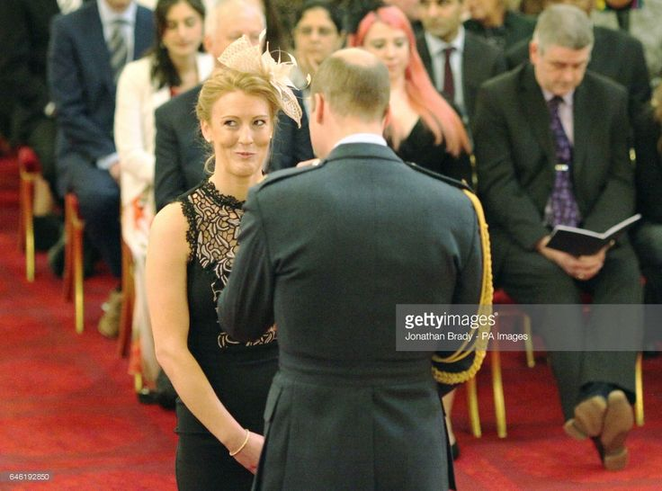 Nicola White, from London, a member of Britain's Olympic gold medal-winning women's hockey team, is made an MBE (Member of the Order of the British Empire) by the Duke of Cambridge at Buckingham Palace.