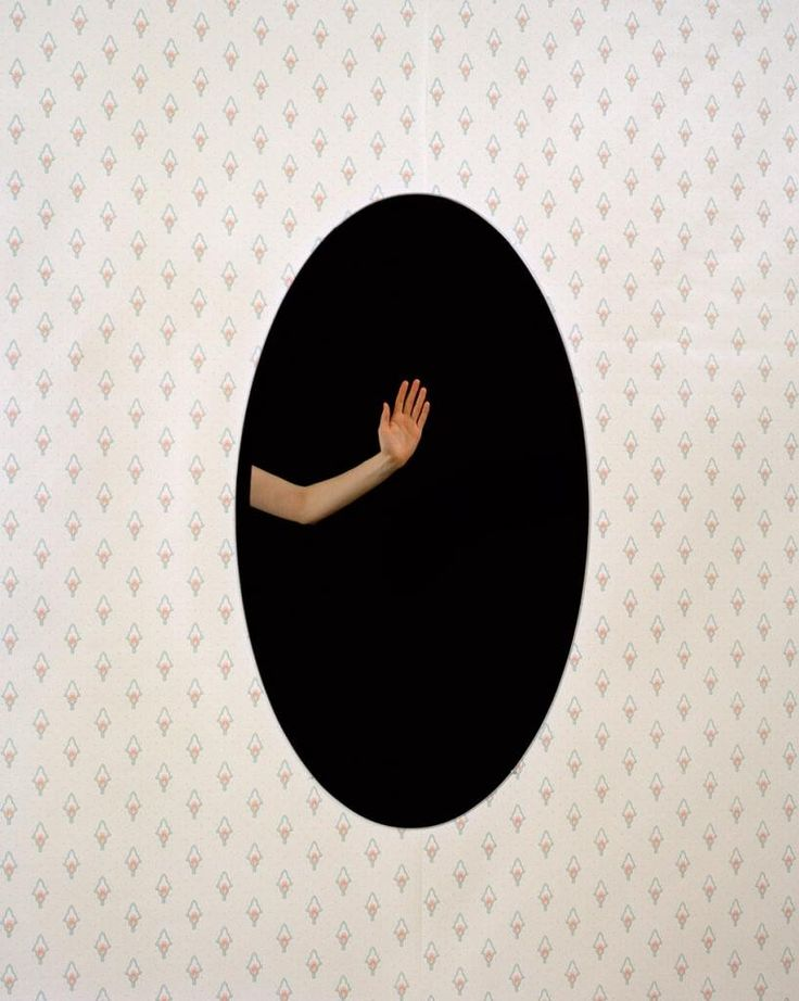 """14x11 in. Elise Victoria Louise Windsor Ovoid (right). The photograph """"Ovoid (left)"""" and """"Ovoid (right)"""" from the series mise en abyme (placing into infinity), are portraits of my arm waving into a mirror that reflects into the camera, that is nowhere in the shot. My hand engages the camera, but it appears as if I am stuck within a space where I cannot escape. The angle of the photograph is vital in creating the illusion as it seems logically unacceptable that the camera cannot be seen..."""