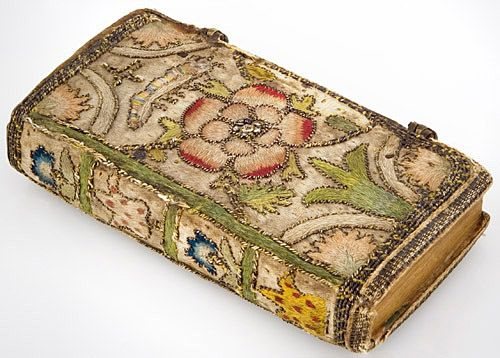 """17th Century English Embroidered Book. The Whole Book of Psalms, Embroidered book binding, 1643. Front: Embroidered w/ an English rose. Back: Embroidered w/ a thistle (traditional symbol for Scotland). Spine: Embroidered with four flowers. 2 brass clasps closures. 4 1/8"""" x 2 1/8"""" x 0.75"""""""