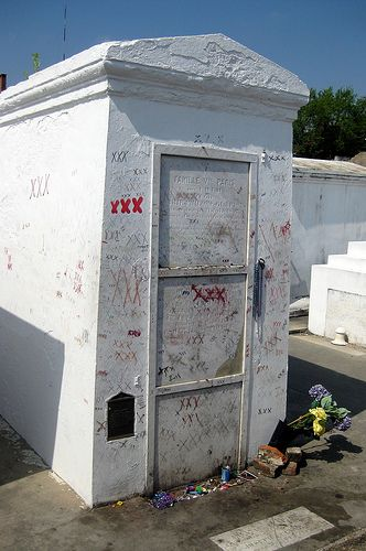 Marie Leveau's grave in St. Louis Cemetery no. 1. She is buried in this cemetery along with her daughter, and the Voodoo King (aka Chicken Man). Three X's on any of these voodoo graves promises fulfillment of wishes, and good luck. I made an offering when I visited. Six dollars, and a fleur-de-lis pin.