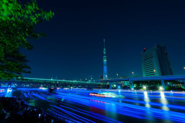 Tokyo Hotaru festival with 100,000 LED hotaru (fireflies) floating down the Sumida River  Photographer: Makure