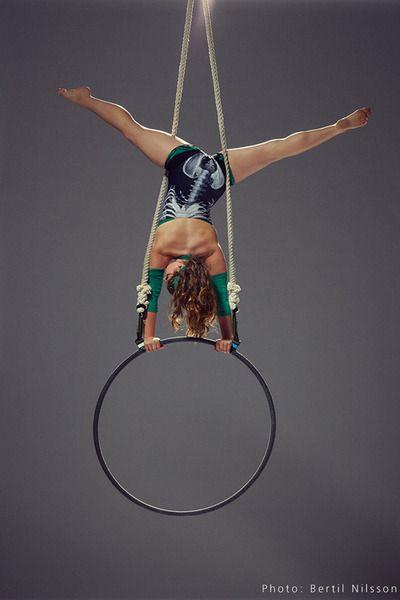 Incredible balance and control!  lyra handstand