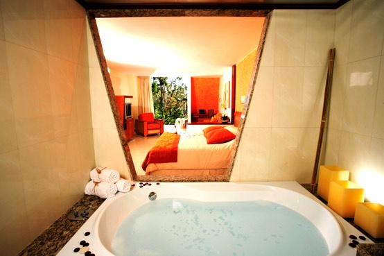 bathroom in room.  Every room has a jacuzzi in it!