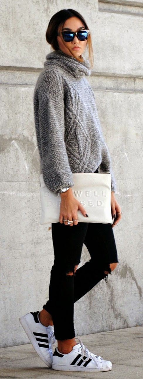 Konni Lechler in her grey knitwear roll neck, black jeans and white clutch from Zara and the sneakers are from Adidas