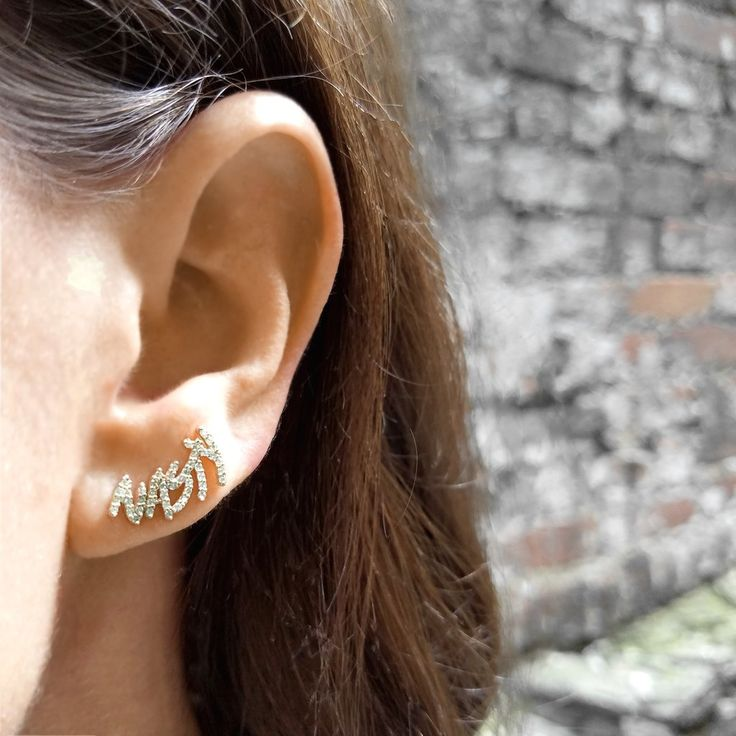 """Nasty White Diamond Climber Earring.  Forming words like """"Warrior"""", """"Resist"""", """"Nasty"""" and """"Fierce"""", the elegant climbers in the fEARce Collection define the commitment and resolve of the millions of women, from Manhattan to Mumbai, fighting for fairness, equality, and respect. A portion of the proceeds from this collection will go to charities supporting women's rights and education.  Available Exclusively from the EarStylist by Jo Nayor.  www.EarStylist.com"""