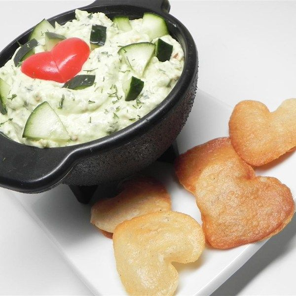 "Tzatziki Guacamole | ""A yummy dip that can be used instead of traditional guacamole or tzatziki. I made it for a family dinner and served it with nacho chips and veggie chips. It would be great with pitas or in a sandwich. Something a little different to add to your table."""