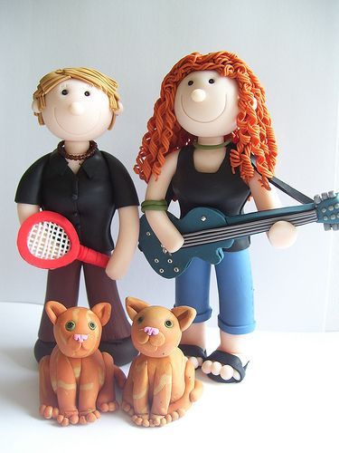 A topper featuring a tennis fan and a guitarist - and their cats of course.