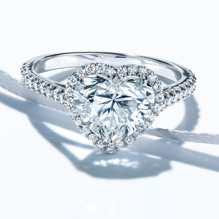 Seriously. I absolutely LOVE this ring. I think I'll buy 1.5 ct for myself one day!!!  The iconic Tiffany Soleste® ring offers classic sophistication in a variety of striking shapes. A scintillating center stone is surrounded by bead-set diamonds that create a captivating halo effect.