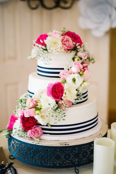 Preppy wedding cake idea - summer wedding cake with blue + white ribbon and cascading, bright flowers {E and E photography}