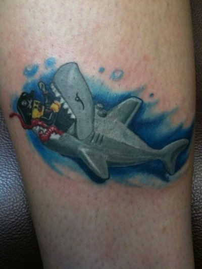 I'm doing a shark themed blog post and had to share this. Sharks + Legos = Awesome Tattoo #SharkWeek