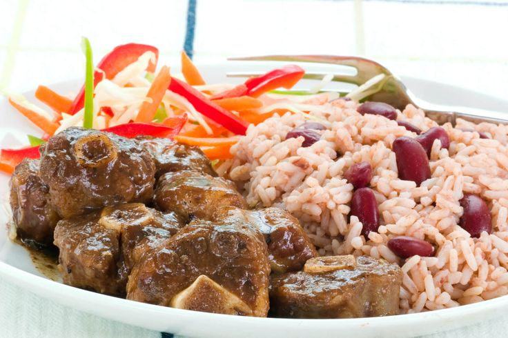 Jamaican Oxtail is well seasoned and cooked for multiple hours until the meat is so tender, you'll even try to eat the bone!