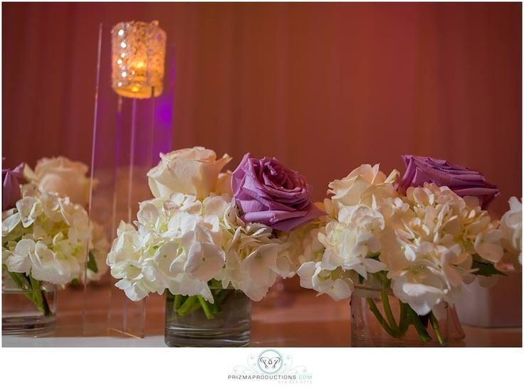 Pink and white rose in hydrengea desing for head table
