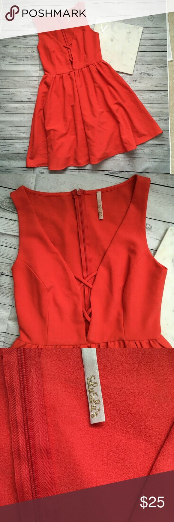 lulu womens small orange formal dress lulus strapp gently used with no flaws formal dress with low v-neck  armpit to armpit = 14.5 inches length = 33 inches Lulu's Dresses Mini
