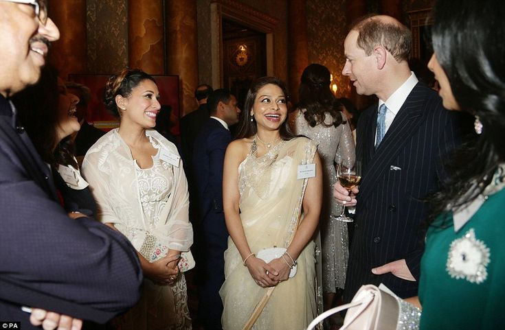 Prince Edward, right, speaks to actresses Preeya Kalidas (left) and Ayesha Dharker, as he greets the high-profile guests at the reception
