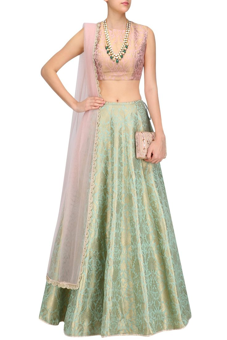 Payal Singhal a dusky rose sleeveless blouse in brocade. It comes along with mint lehenga in brocade and dusky rose dupatta in net with crochet lace.