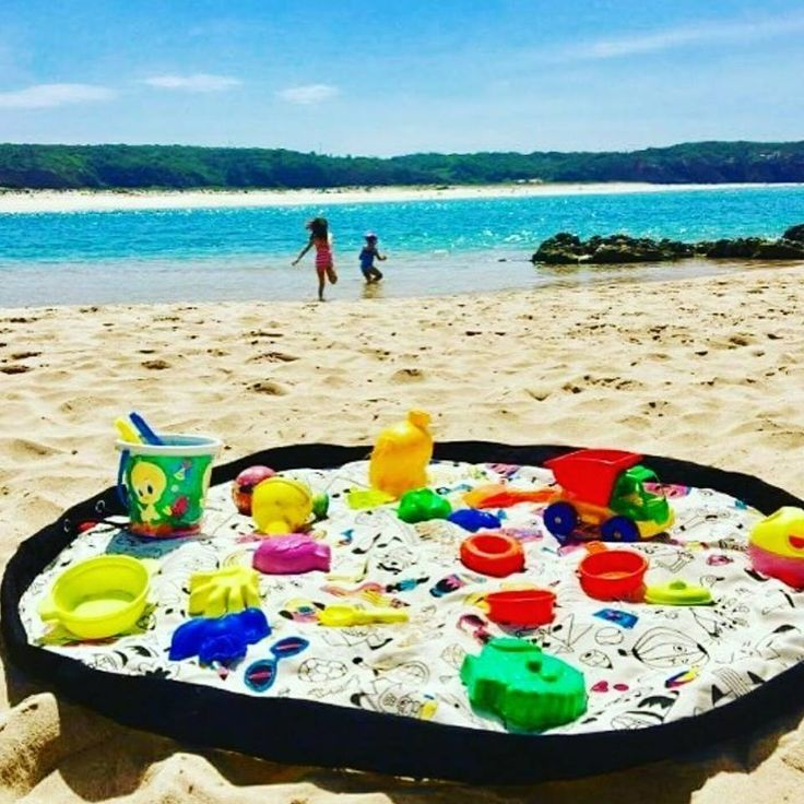 Did you know that you can take your Play & Go bag to the beach? Curry all of your toys easily and open it to create the perfect playmat on the sand!!