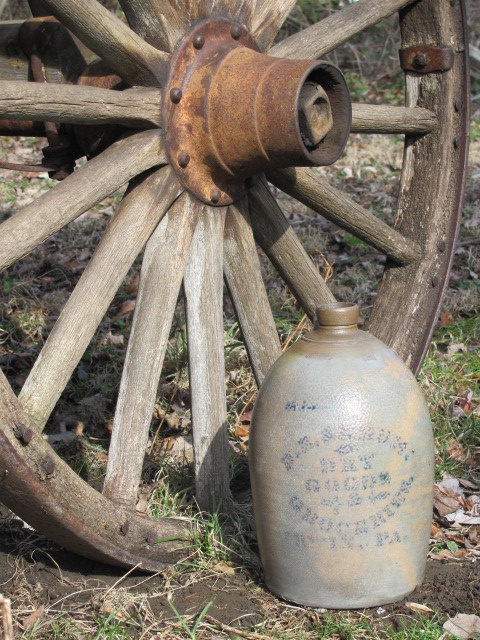 Antiquity...Weathered & Worn Old Wheel and Olde Crock Jug.