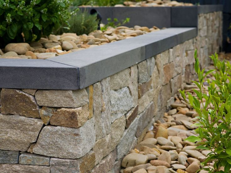 Eco Outdoor bluestone rebated capping with Alpine dry stone walling, Campbell & Johns Landscapes. Eco Outdoor | Bluestone tiles | livelifeoutdoors | Outdoor Design | Natural stone flooring | Garden design | Outdoor paving | Outdoor design inspiration | Outdoor style | Outdoor ideas | Luxury homes | Paving ideas | Garden ideas | Natural stone paving | Floor tiles | Outdoor tiles | Courtyard design