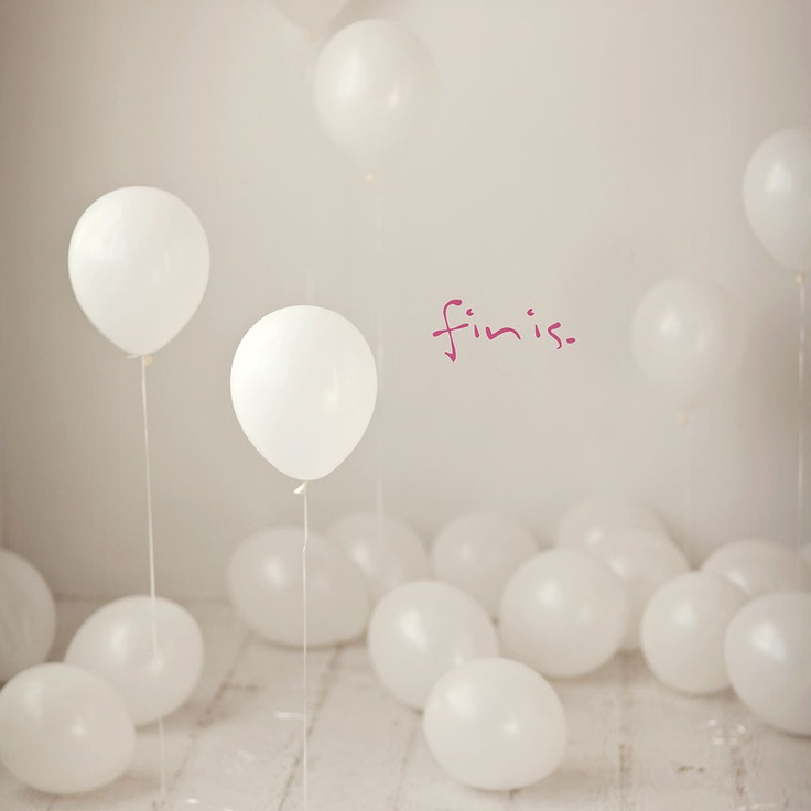I like the idea of doing everything white and all the balloons.  I love balloons.