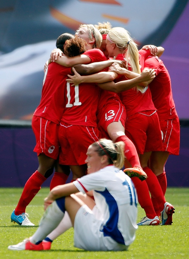 Players from Canada celebrate after defeating Camille Abily #10 and France to win the bronze medal during the women's football bronze medal match.