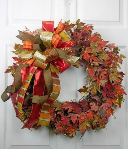 """From our Designer Series and full of pumpkin stems and berries with twisting vines, fall leaves, and dried bean stems, this oversized wreath will make a big impression for your front door. A 13""""W X 18"""