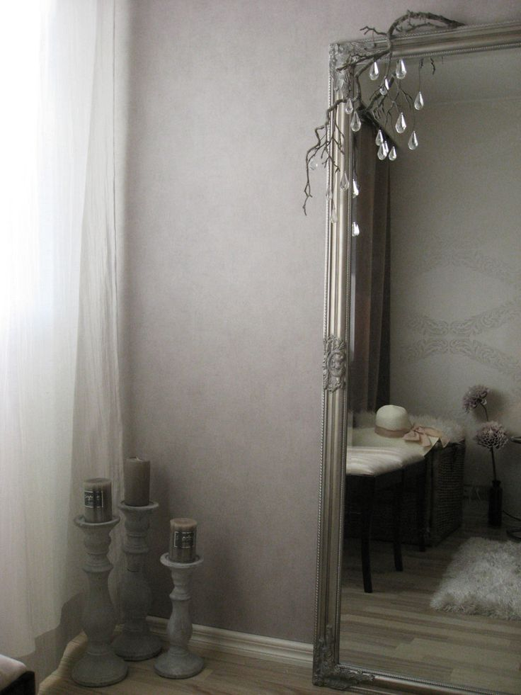 White and gray bedroom, silver frame mirror, gray wallpaper