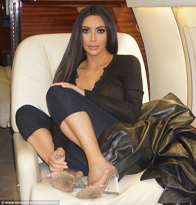 Poor little rich girl: Kim Kardashian flaunts her VIP life as she curled up on a jet in this behind-the-scene image she shared to kimkardashianwest.com on Thursday