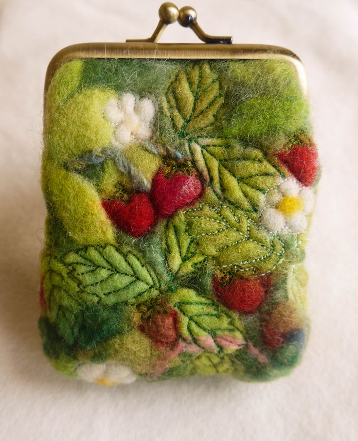 Clasp purse made from wet felt, embroidered with wild strawberries. http://feltiefare.com/