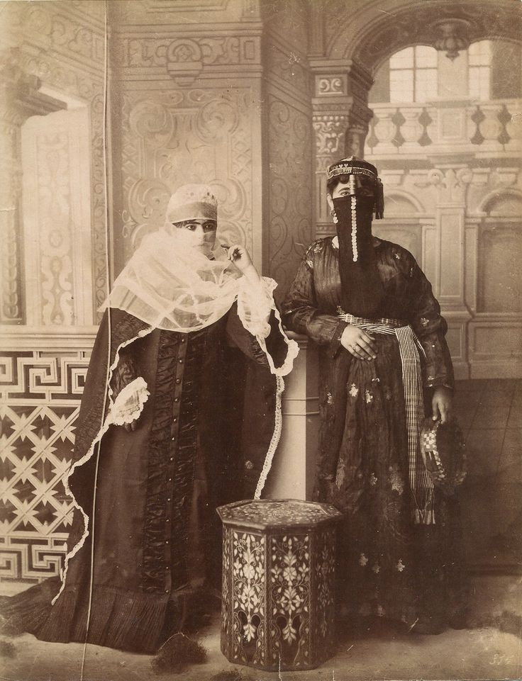 Turkish women in Ottoman Empire.1885. Traditional costumes with veil. Left: Turkish urban style. Right: Arab style.