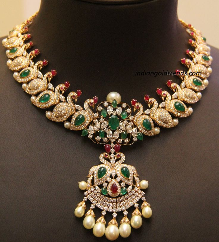 Designer peacock motifs diamond necklace with peacock design pendant having south sea pearls and studded with rubies and emeralds.