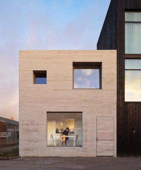 Dutch office Studio MAKS has built a compact concrete house in an old industrial area of the Netherlands.
