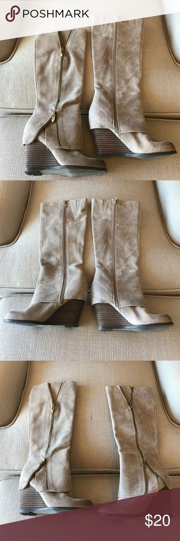 Fergie boots size 6.5 Color is a little tough to explain. Almost between a really light pink and tan. Very cute boots. Worn several times but still in very good condition. Fergie Shoes Wedges