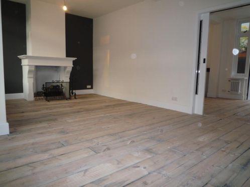 prachtige houten vloer: oud grenen planken uit wagons