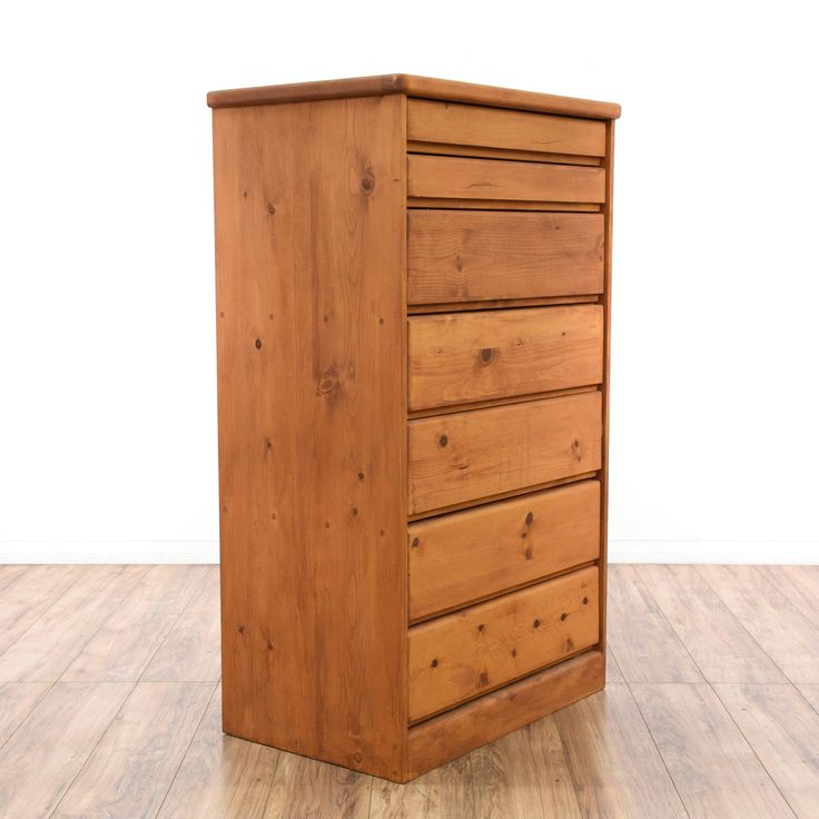 This contemporary dresser is featured in a raw pine finish. This tall dresser has 7 drawers in varying sizes with modern carved trim. Great for a large bedroom!  #contemporary #dressers #talldresser #sandiegovintage #vintagefurniture