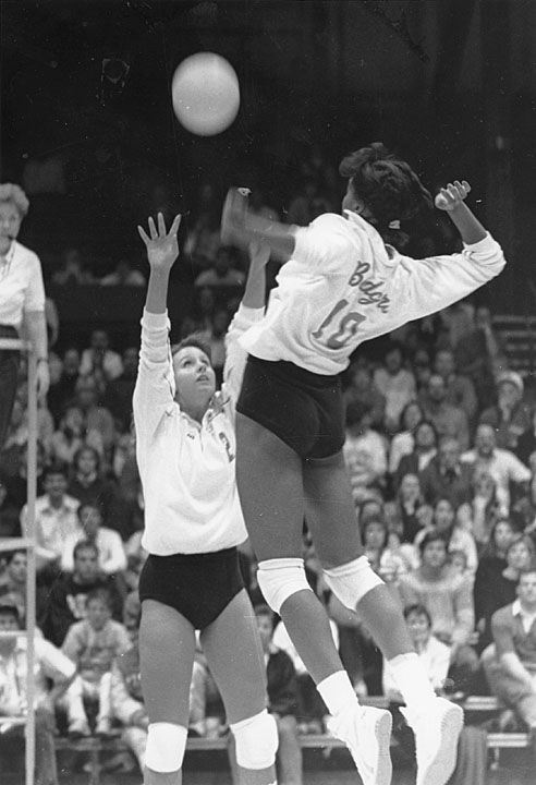 University of Wisconsin-Madison women's volleyball game, ca. 1988. Lisa Hagan, #10, is spiking the ball that was set by Susan Temple, #2. Source: UW-Madison Archives.