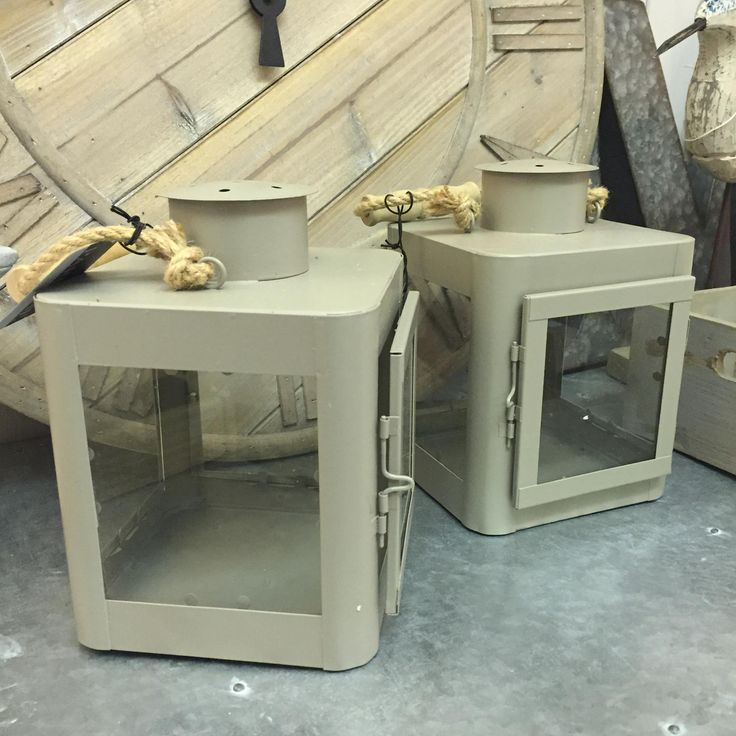 Chunky metal lanterns with a sturdy rope handle. Ideal for outdoor use to burn your candles safely.