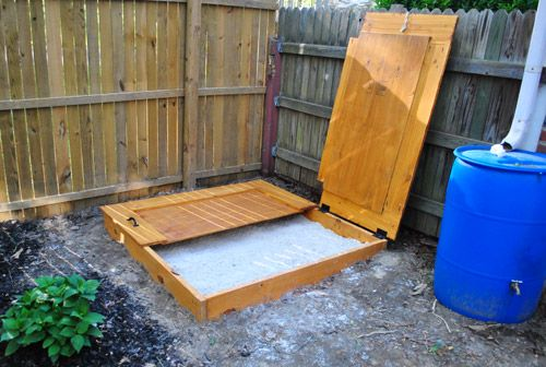 Cover for sandbox - love how they secured it to the fence so it wouldn't fall back down while the kiddos play.